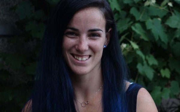 Headshot of Lizzy Schwartz, head rigger and flying trapeze coach.