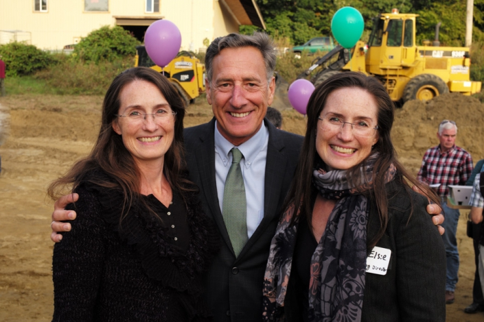 photo of Vermont senator smiling with the founders of NECCA at the new facility construction site.