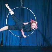 aerial hoop artist performing on stage