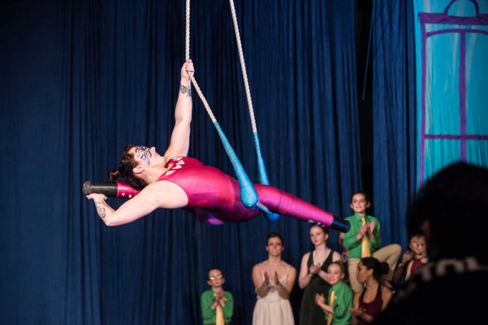 photo of Erin Ball, double leg amputee, performing at NECCA's Flying Nut Christmas show