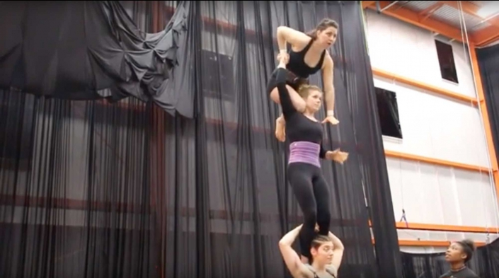 photo of three women performing a three high for the show Fractured, at the NEw England CEnter for Circus Arts